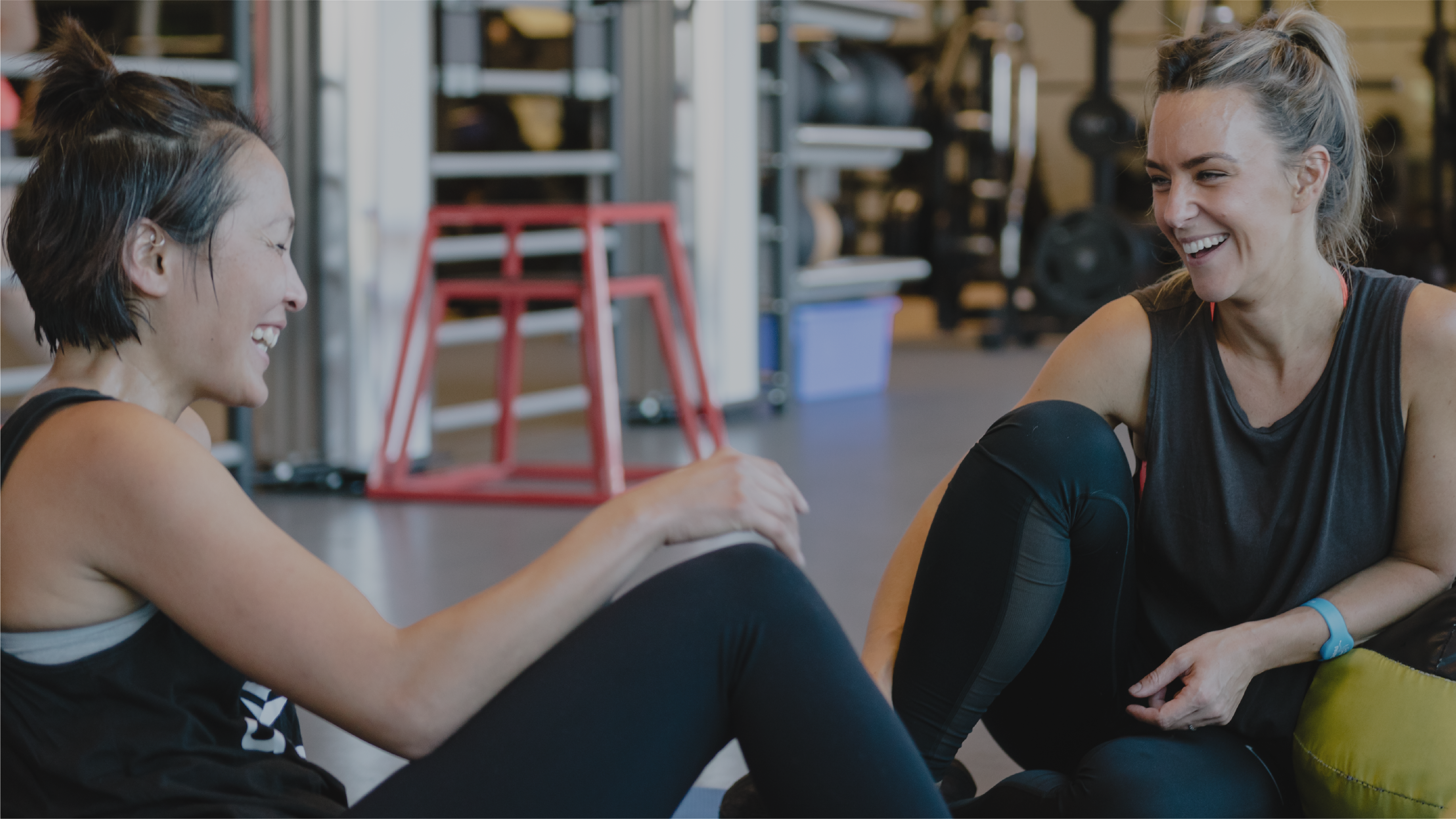 Two girls talking in the gym