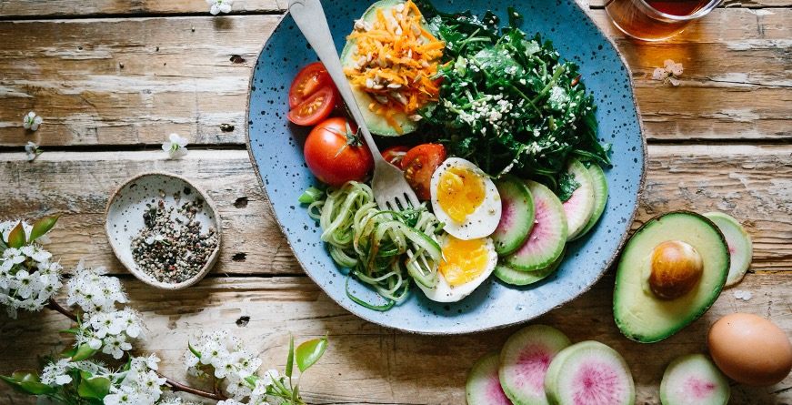 image of food on table, vegetables, avocado, egg.